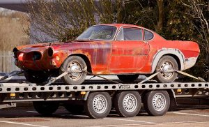 car on flatbed of tow truck
